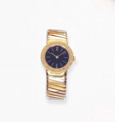 A LADY'S GOLD WRISTWATCH, BY B