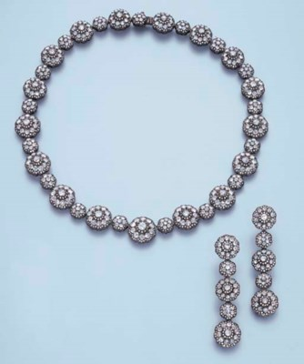 A DIAMOND FLORAL NECKLACE AND