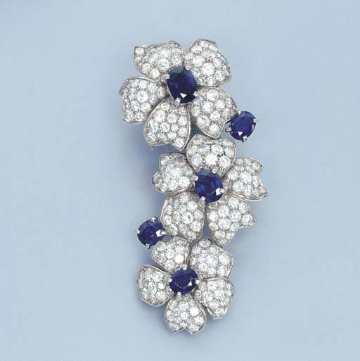A SAPPHIRE AND DIAMOND FLORAL