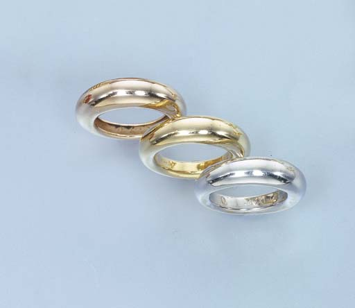 A SET OF THREE GOLD RINGS, BY