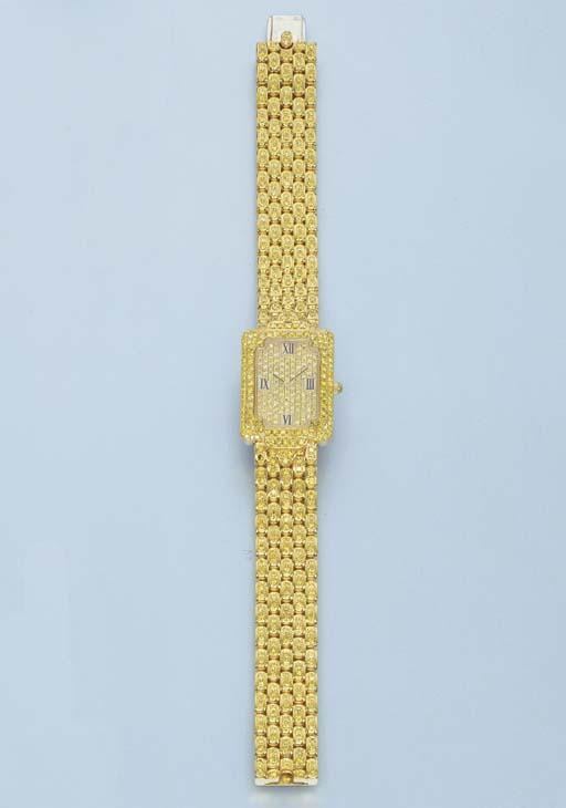 A YELLOW DIAMOND WRISTWATCH, B