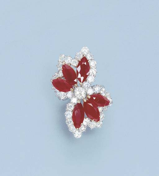 A RUBY AND DIAMOND FLORAL RING