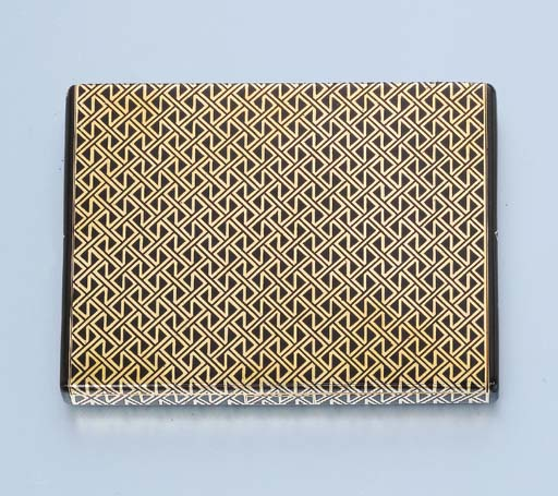 AN ART DECO GOLD AND ENAMEL CI
