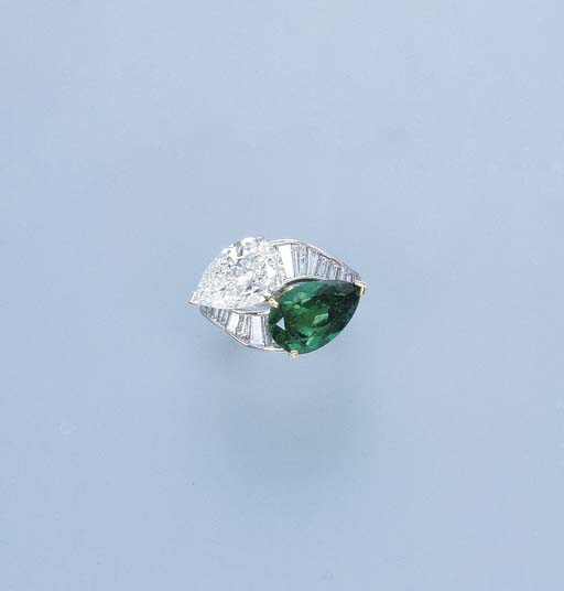 AN EMERALD AND DIAMOND CROSS-O
