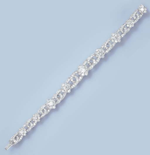 A DIAMOND FLORAL BRACELET, BY
