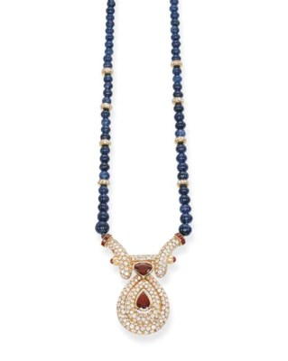 A SAPPHIRE BEAD, RUBY AND DIAM