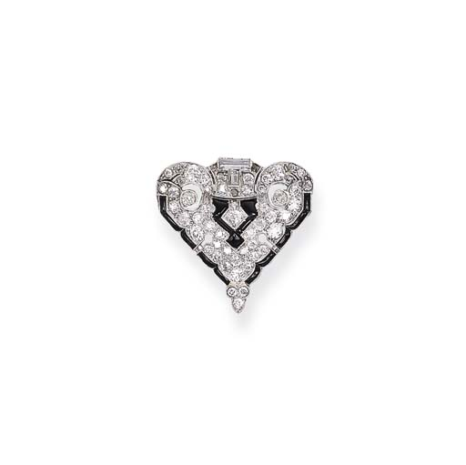 AN ART DECO ONYX AND DIAMOND B