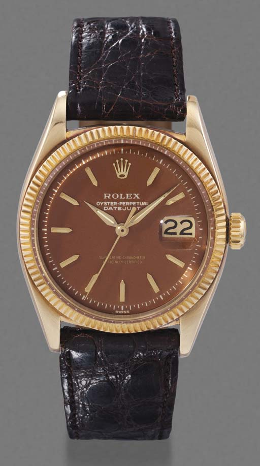 Rolex. A 14K gold self-winding