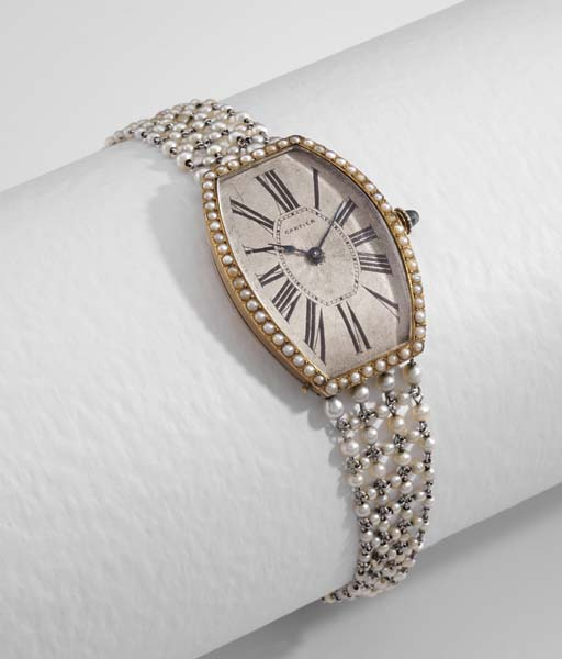 Cartier. A fine 18K gold and p