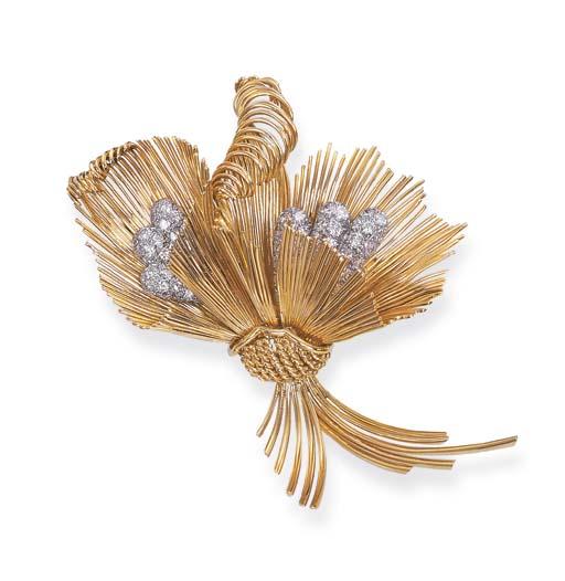 A GOLD AND DIAMOND SPRAY BROOC