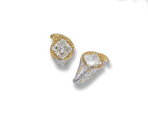 A PAIR OF DIAMOND FLORAL EAR C