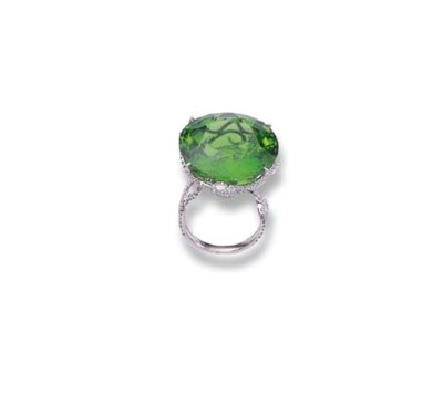 A PERIDOT AND DIAMOND RING, BY