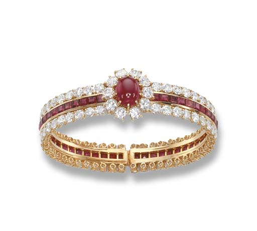 A RUBY AND DIAMOND BANGLE, BY