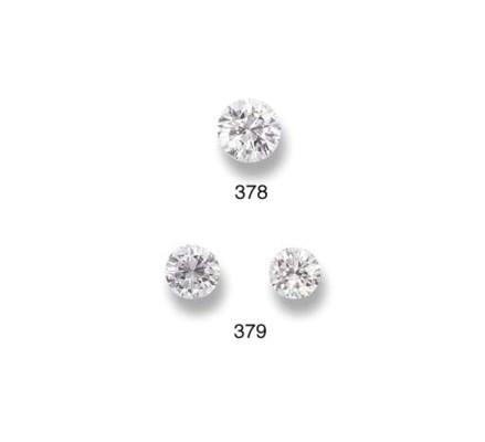 A PAIR OF UNMOUNTED DIAMONDS