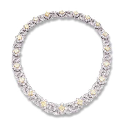 A DIAMOND FLORAL NECKLACE, BY