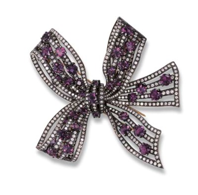 AN AMETHYST AND DIAMOND BOW BR
