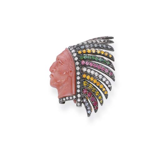 A CORAL AND GEM-SET RED INDIAN