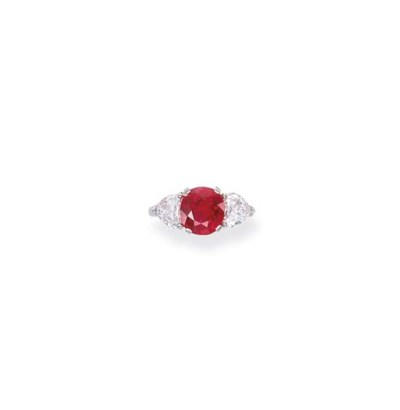 A RUBY AND DIAMOND RING, BY SP