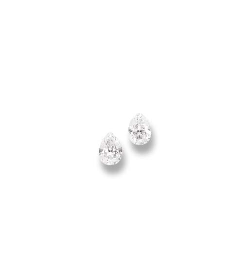 A PAIR OF UNMOUNTED DIAMONDS