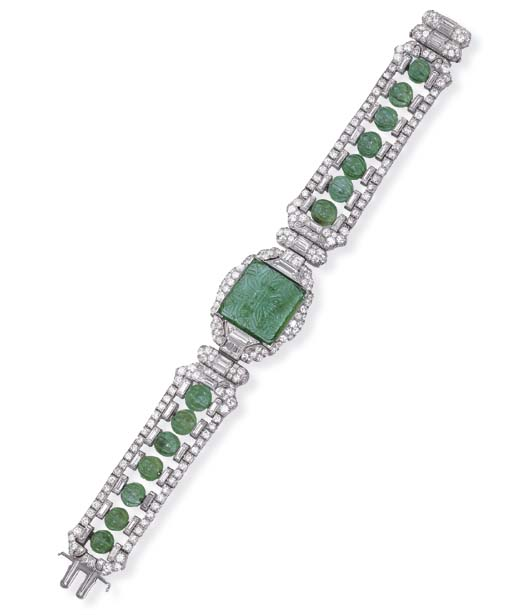 AN ART DECO EMERALD AND DIAMON