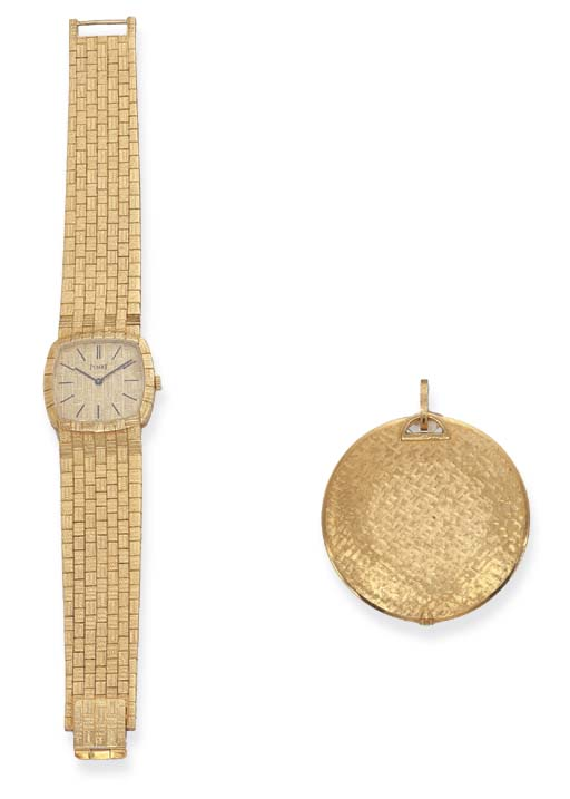 A GOLD WRISTWATCH AND A PENDAN