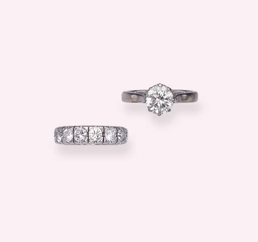 A DIAMOND SINGLE-STONE RING AN