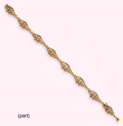 AN ANTIQUE GOLD BRACELET AND A