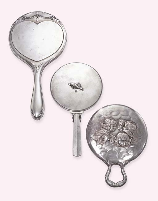 TWO SILVER HAND MIRRORS AND A
