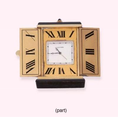 AN ONYX DESK CLOCK, BY CARTIER