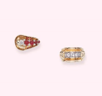 TWO GOLD AND DIAMOND RINGS