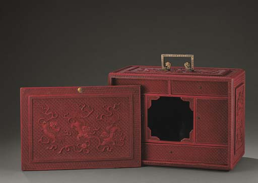A WELL CARVED CINNABAR LACQUER