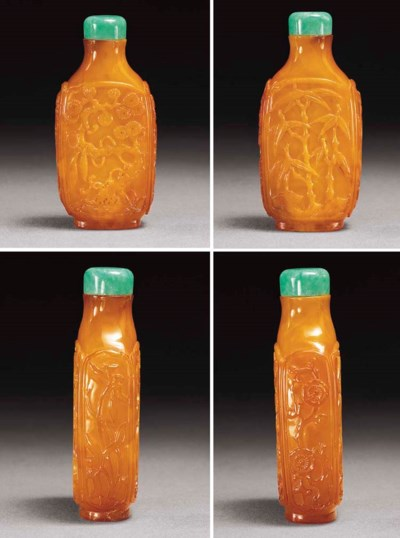 A VERY RARE CARVED AMBER SNUFF