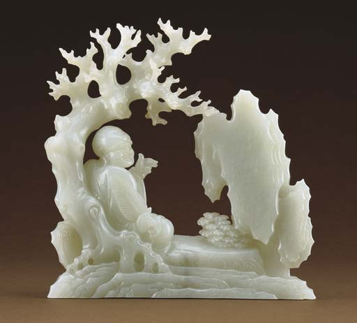 A FINELY CARVED WHITE JADE LUO
