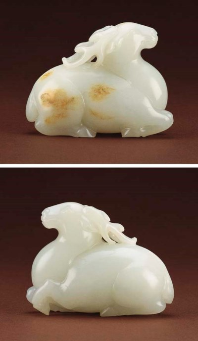A SUPERB WHITE JADE CARVING OF