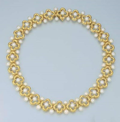 A CULTURED PEARL AND 18K GOLD