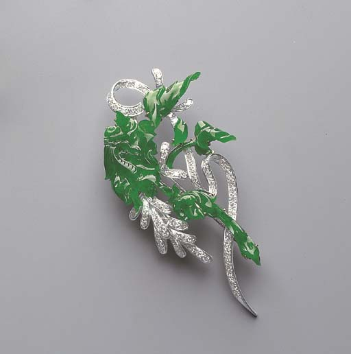 A CARVED JADEITE AND DIAMOND B