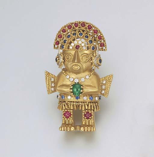 AN AZTEC STYLE 18K GOLD, DIAMOND AND MULTI-GEM FIGURINE CLIP BROOCH