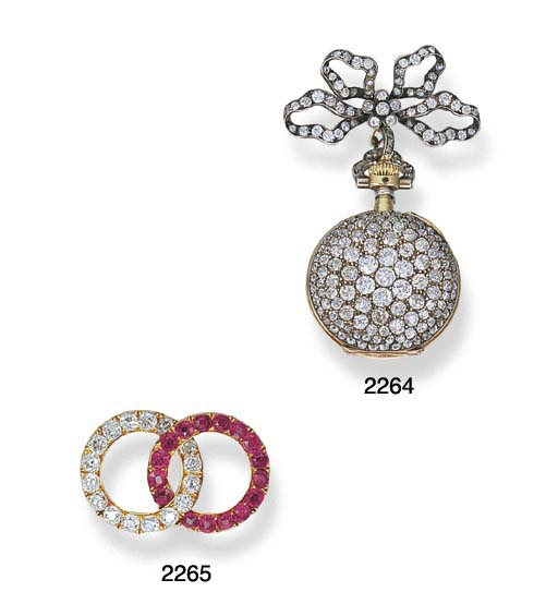 AN ANTIQUE DIAMOND AND RUBY BROOCH