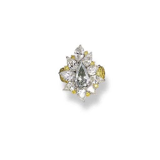 A COLOURED DIAMOND AND DIAMOND RING