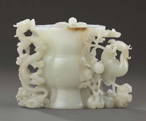 A FINE WHITE JADE 'DRAGON AND