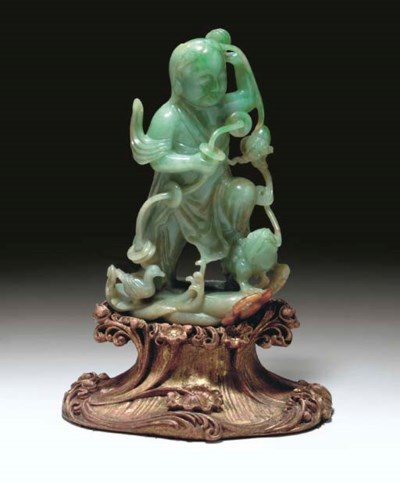 A FINELY CARVED JADEITE FIGURE