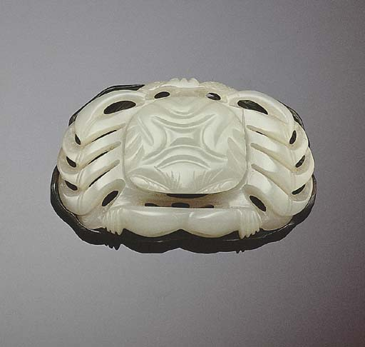 A FINE WHITE JADE CARVING OF A