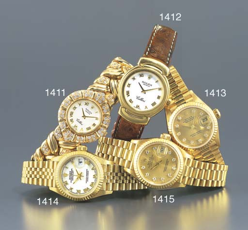 ROLEX. A LADY'S 18K GOLD WRIST
