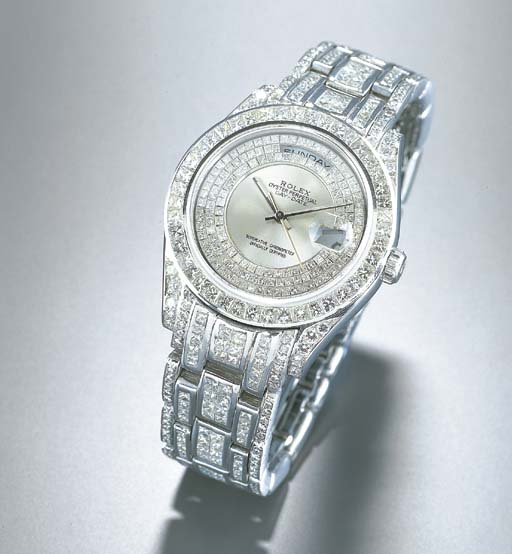 ROLEX. AN 18K WHITE GOLD AND L