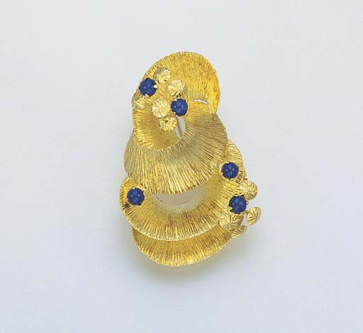 AN 18K GOLD AND DYED LAPIS LAZ