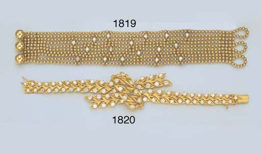 AN 18K GOLD BEAD CHAIN AND DIA