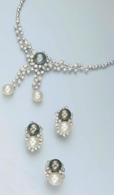 A SUITE OF SOUTH SEA WHITE AND