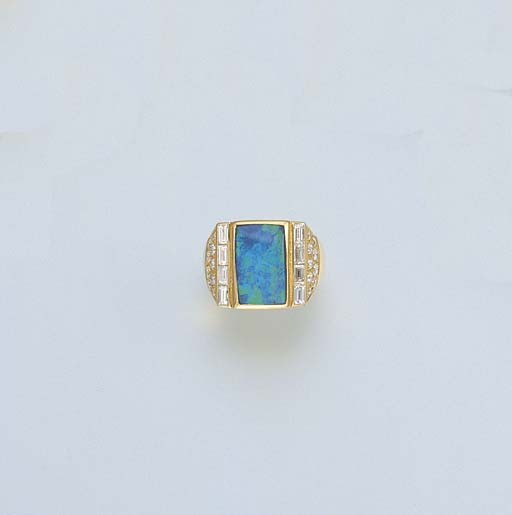 A BLACK OPAL AND DIAMOND RING,