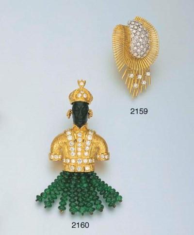 A DIAMOND AND 18K GOLD CLIP BR