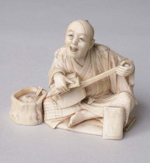 *A JAPANESE IVORY OKIMONO OF A